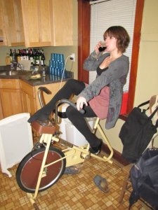 This is a picture of me being a modern young lady by drinking wine on a vintage exercise bike.